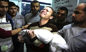 Jihad Misharawi, a BBC Arabic video editor, carrying the body of his dead son