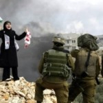 Palestinian woman confronts soldiers