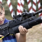 Israeli child holding a gun.jpg