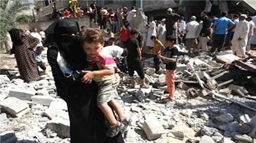 Palestinian woman carrying child in Khan Younis