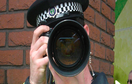 Policeman holding a camera