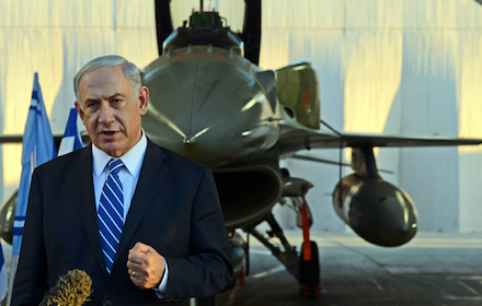 Binyamin Netanyahu with a warplane in the background