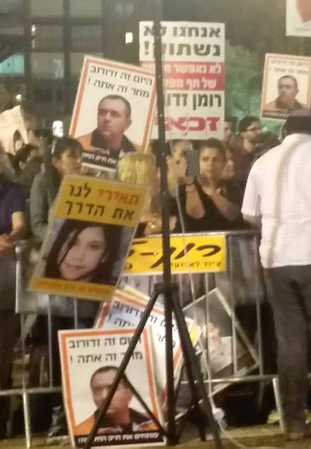 Roman Zadorov supporters holding posters